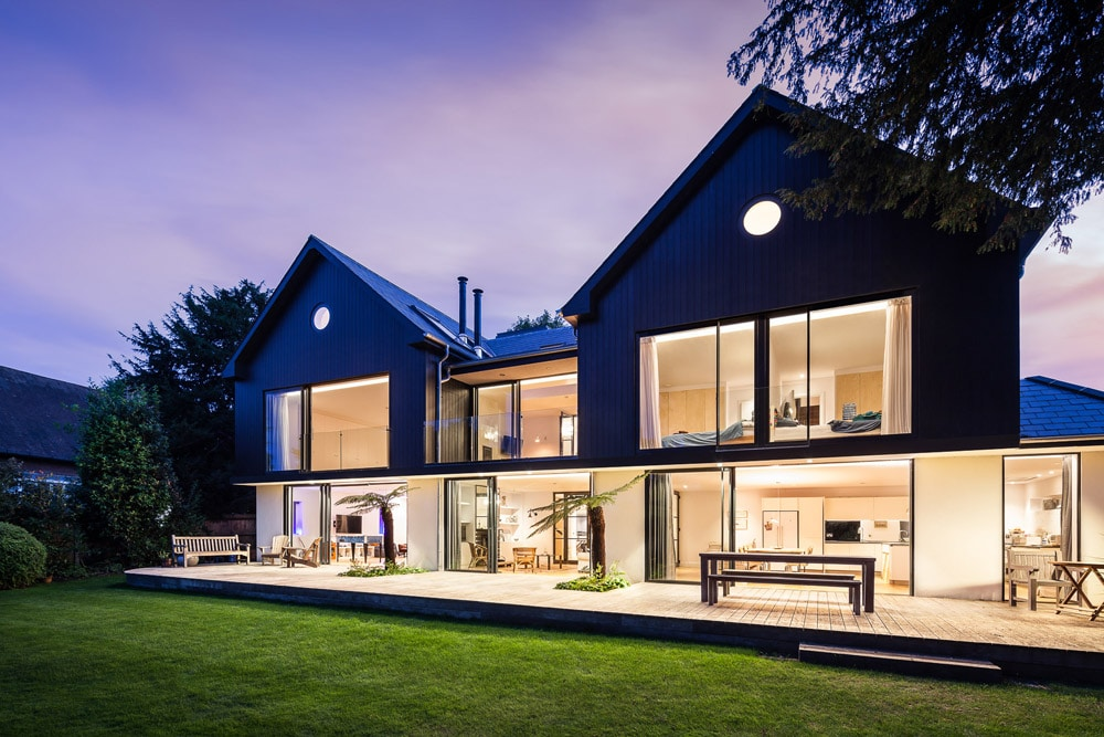 glass exterior to house at night time