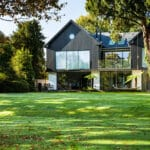 Thumbnail of http://view%20of%20house%20from%20garden%20with%20large%20glass%20windows