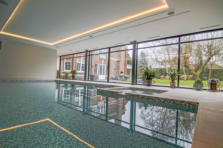 indoor swimming pool with large patio doors