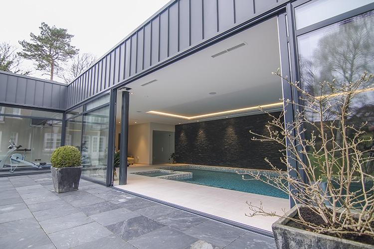 sliding patio doors that lead to indoor pool