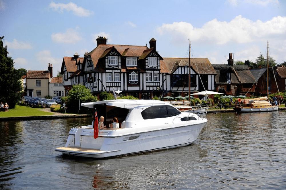 boat on river in sunshine