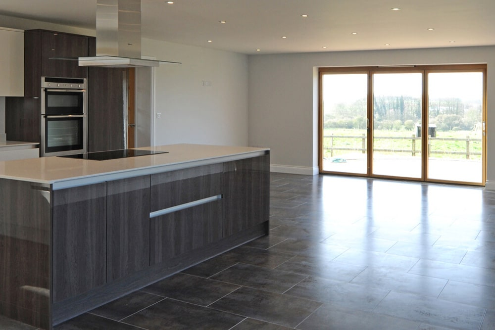 large open plan kitchen with patio doors
