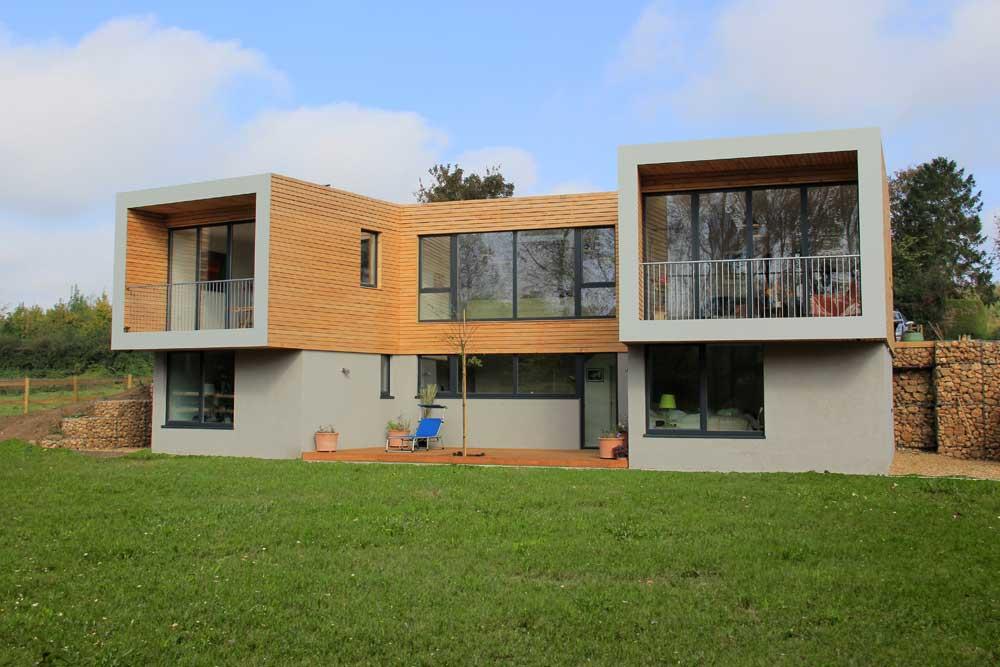 modern house with bifold doors on balcony
