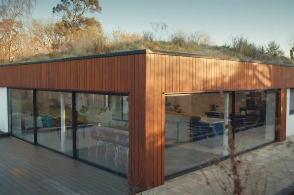 The grass-covered roof traps the heat in during the summer, warming the house during winter