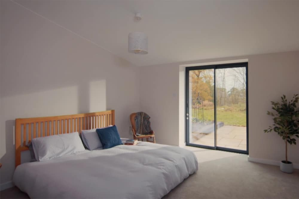 The master bedroom features a set of SVG30 sliding doors