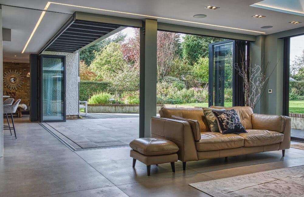 Contemporary Surrey renovation with open corner bifold doors